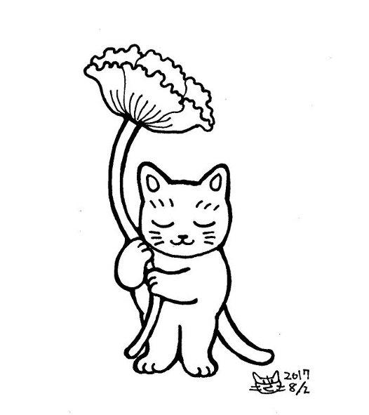 花を持つ猫
